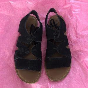 black Toms gladiator sandals